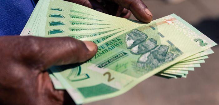 Zimbabwe restores dollar peg as currency crashes